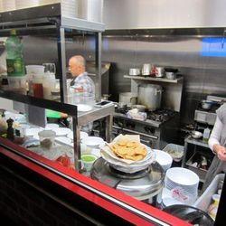 Chef Joshua Clark, left, in the kitchen.