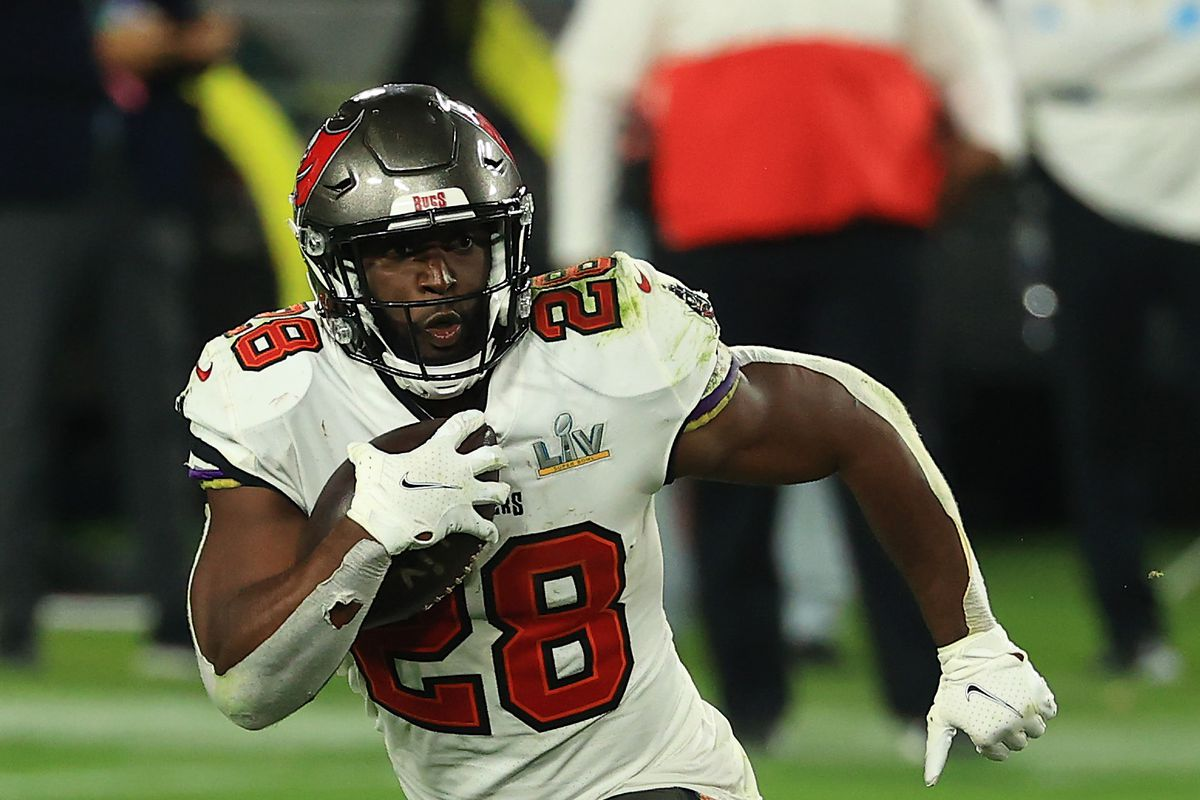 Leonard Fournette #28 of the Tampa Bay Buccaneers rushes during the fourth quarter of the game against the Kansas City Chiefs in Super Bowl LV at Raymond James Stadium on February 07, 2021 in Tampa, Florida.