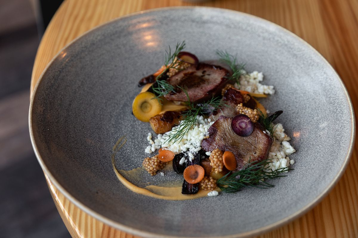 A composed dish of beef tongue with mustard seeds, puffed rice, and carrots in a dish from Marrow