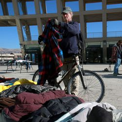 James Stover looks through clothes at the Community Coat Exchange in the Salt Lake City Library Plaza in Salt Lake City on Friday, Nov. 29, 2013.