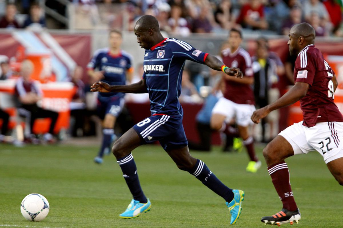 April 1, 2012; Commerce City, CO, USA; Chicago Fire forward Dominic Oduro(8) advances the ball around Colorado Rapids defender Marvell Wynne at Dick's Sporting Goods Park. Mandatory Credit: Andrew Carpenean-US PRESSWIRE