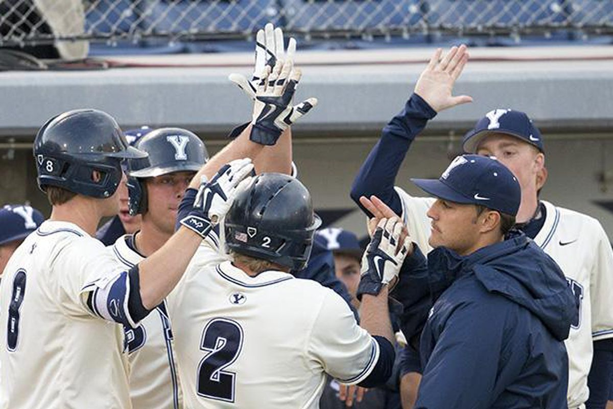 BYU players celebrate during a win at home.