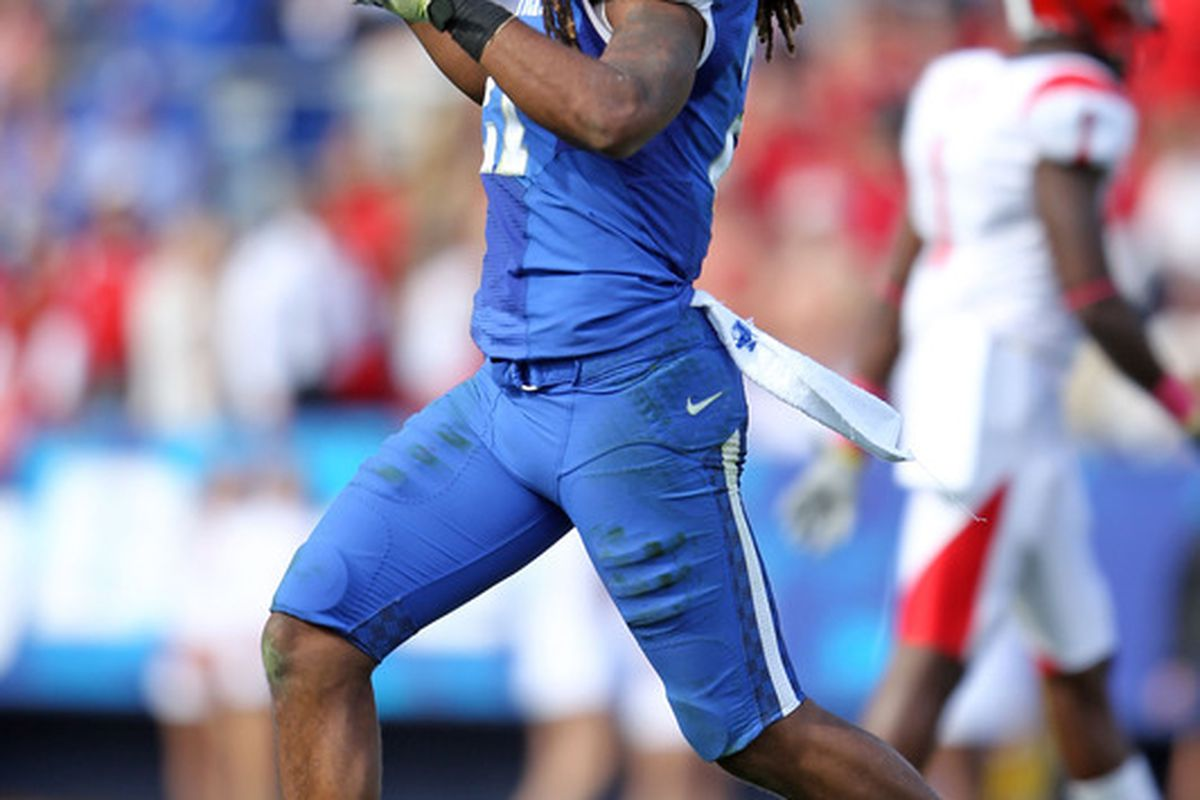 LEXINGTON, KY - OCTOBER 22:  Winston Guy #21 of the Kentucky Wildcats celebrates during the game against the Jacksonville State Gamecocks at Commonwealth Stadium on October 22, 2011 in Lexington, Kentucky.  (Photo by Andy Lyons/Getty Images)