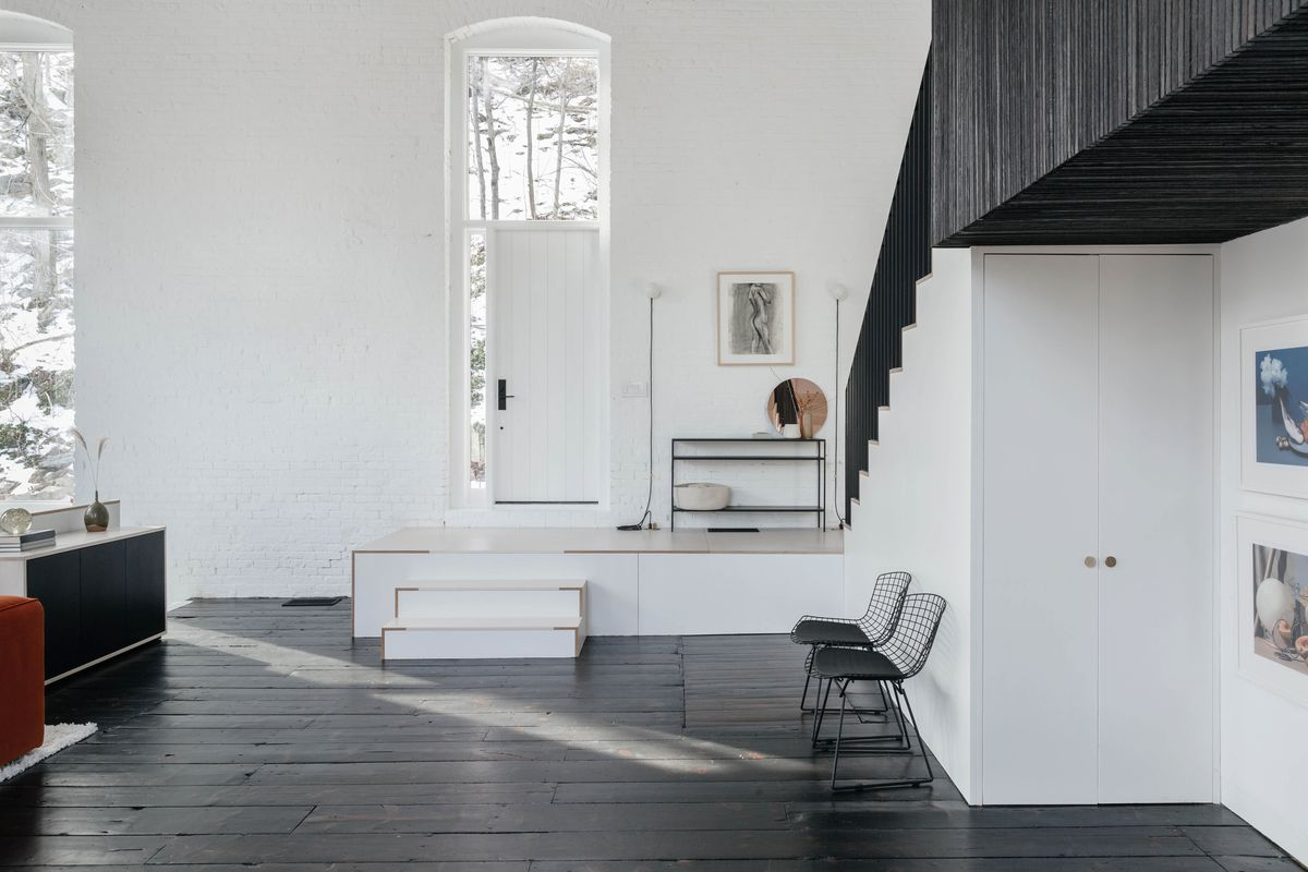 Entryway with white door and walls.
