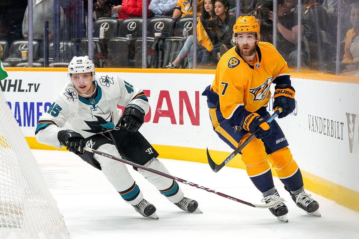 Yannick Weber #7 of the Nashville Predators skates against Lean Bergmann #45 of the San Jose Sharks at Bridgestone Arena on October 8, 2019 in Nashville, Tennessee.