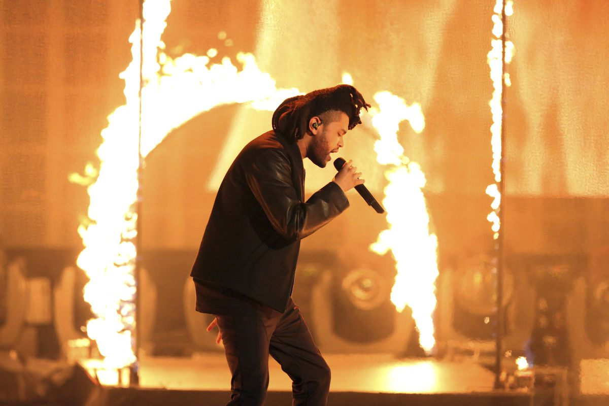 """In this Sunday, Nov. 22, 2015, file photo, the Weeknd performs at the American Music Awards at the Microsoft Theater in Los Angeles. The Weeknd had the No. 1 song of 2020 but """"Blinding Lights"""" was not nominated for a Grammy Award."""