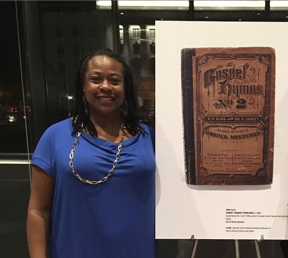 Sun-Times reporter Maudlyne Ihejirika with one of the items on display at the Smithsonian's newest museum.
