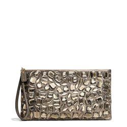 "<a href=""http://f.curbed.cc/f/Coach_SP_110713_zipclutch"">Madison Zip Clutch in Jeweled Leather</a>, $458"