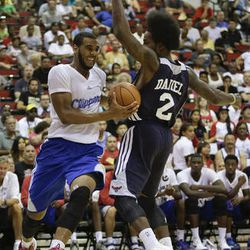 Los Angeles Clippers Brandon Davies drives to the basket against Atlanta Hawks Ed Daniel in the fourth quarter of an NBA Summer League game, Friday, July 12, 2013, in Las Vegas.