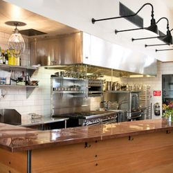 The open kitchen and chef's counter