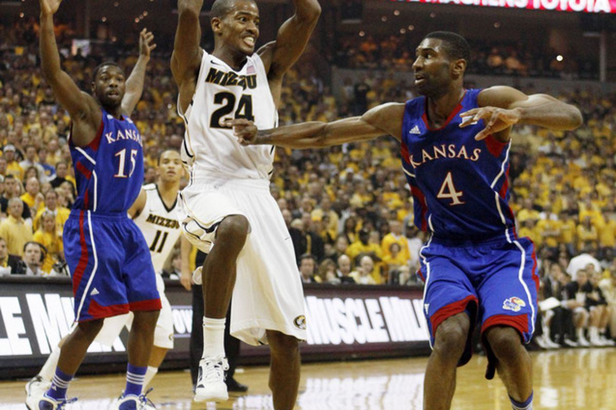 COLUMBIA, MO - FEBRUARY 04:  Kim English #24 of the Missouri Tigers looks to pass over Justin Wesley #4 of the Kansas Jayhawks during the first half at Mizzou Arena on February 4, 2012 in Columbia, Missouri. (Photo by Ed Zurga/Getty Images)