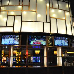 Six HDTV's are mounted behind the bar.