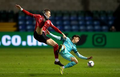 Lincoln City v Liverpool - Carabao Cup Third Round - New signing Kostas Tsimikas makes a tackle against Lincoln City
