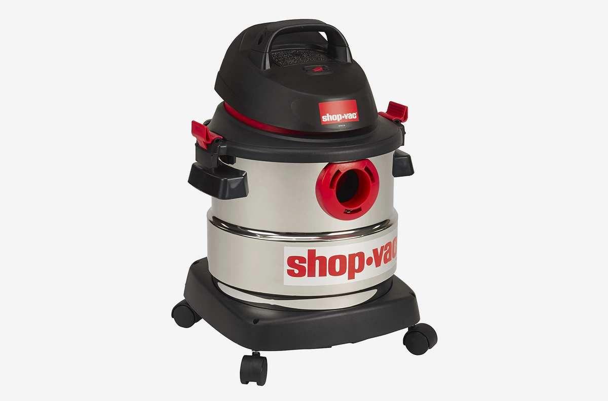 A cylindrical vacuum on wheels.