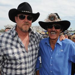 Country singer Trace Adkins, left, and seven-time NASCAR champion Richard Petty meet before the NASCAR Sprint Cup Series auto race Sunday, April 1, 2012, in Martinsville, Va.
