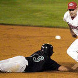 Salt Lake's Zach Sorensen reaches for the ball as Colorado Springs' Ryan Spilborghs slides back into second base.