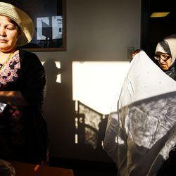 Volunteers Behrouzi Tahereh, left, and Zainab Sokeki organize clothes at the Mosaic Inter-Faith center in Salt Lake City on Thursday, Aug. 4, 2016.