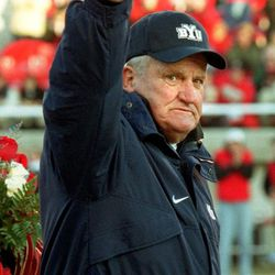 BYU football coachLaVell Edwards waves to the crowd at the University of Utah before coaching his last football game on Nov. 24, 2000.
