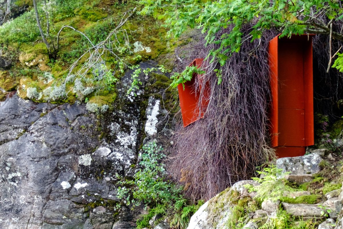 Hut with red door and window.