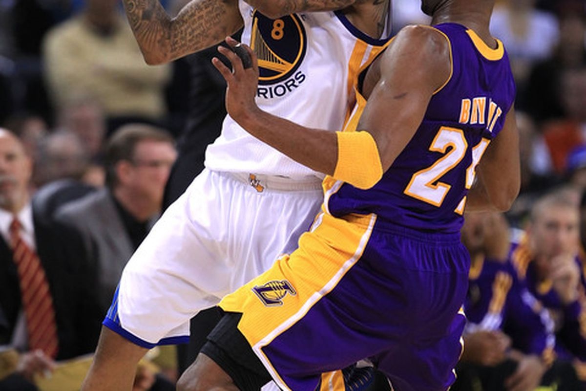 OAKLAND CA - JANUARY 12:  Kobe Bryant #24 of the Los Angeles Lakers plays tight defense on Monta Ellis #8 of the Golden State Warriors at Oracle Arena on January 12 2011 in Oakland California.  (Photo by Ezra Shaw/Getty Images)