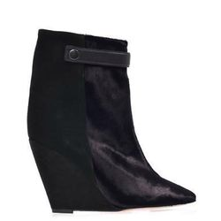 """<a href=""""http://www.matchesfashion.com/product/166106"""">Sade bi-colour wedge boots by Isabel Marant</a>, $553.40 (were $1,385)"""