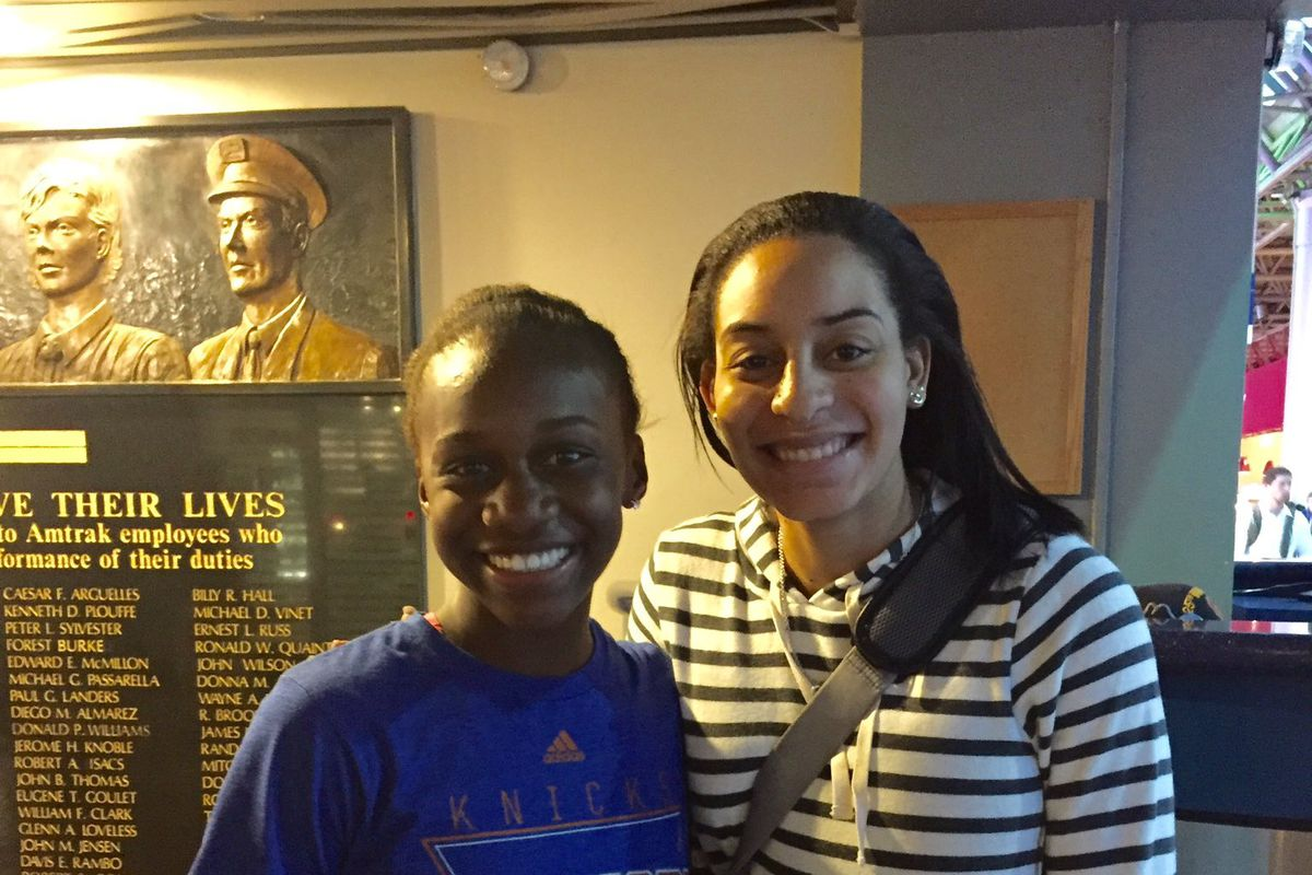 Bria Hartley of the Washington Mystics takes a picture with a fan at Union Station.
