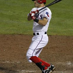 Texas Rangers' Ian Kinsler follows through on a single to left off of Seattle Mariners' Hisashi Iwakuma in the fifth inning of a baseball game Friday, Sept. 14, 2012, in Arlington, Texas.