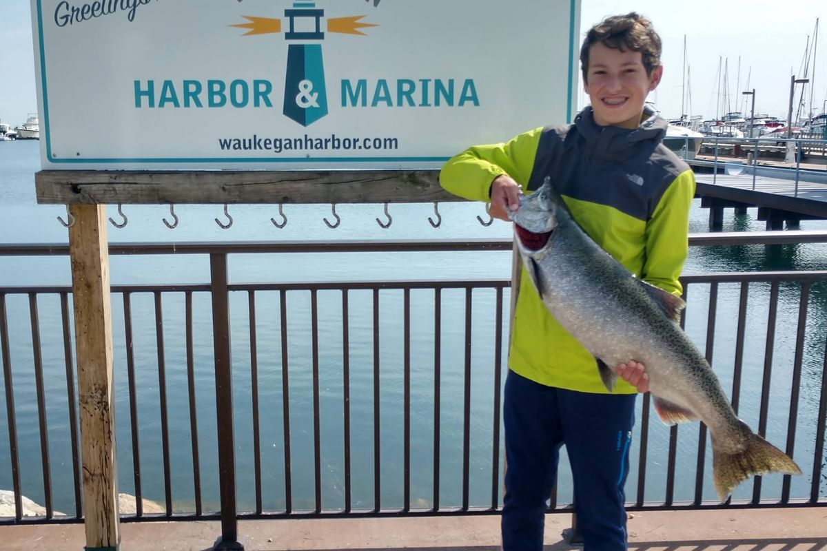Isaac Biggerstaff with a Chinook caught while kayak fishing with his father Matt. Provided photo