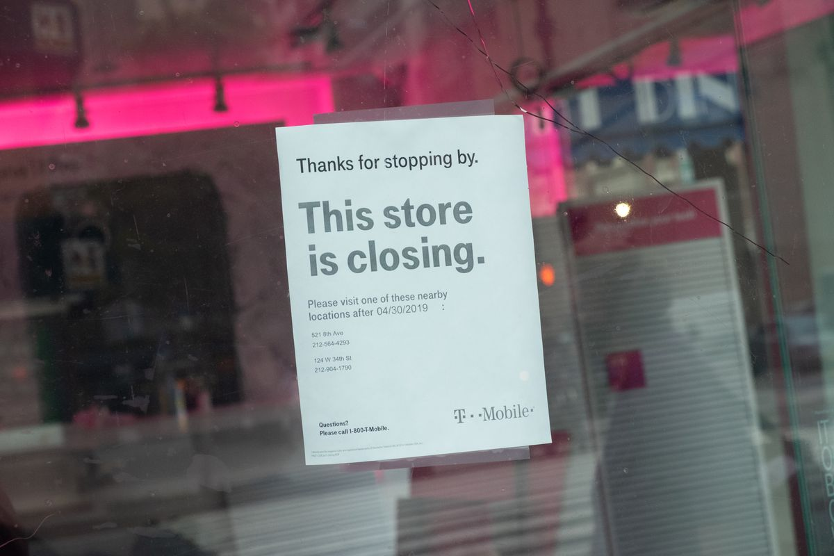 A notice seen hanging at a T-Mobile store announcing its closure