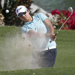 Yani Tseng, of Taiwan, hits from the bunker on the sixth hole during the third round of the LPGA Kraft Nabisco Championship golf tournament in Rancho Mirage, Calif., Saturday, March 31, 2012.