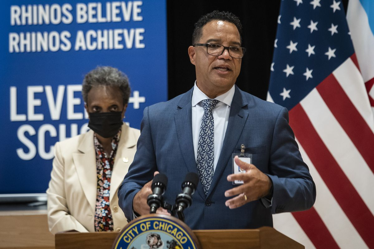 Mayor Lori Lightfoot listens as former Elgin schools superintendent José Torres speaks to reporters after Lightfoot named him interim CEO for Chicago Public Schools during a news conference at Richardson Middle School on the Southwest Side, Monday afternoon, June 14, 2021.