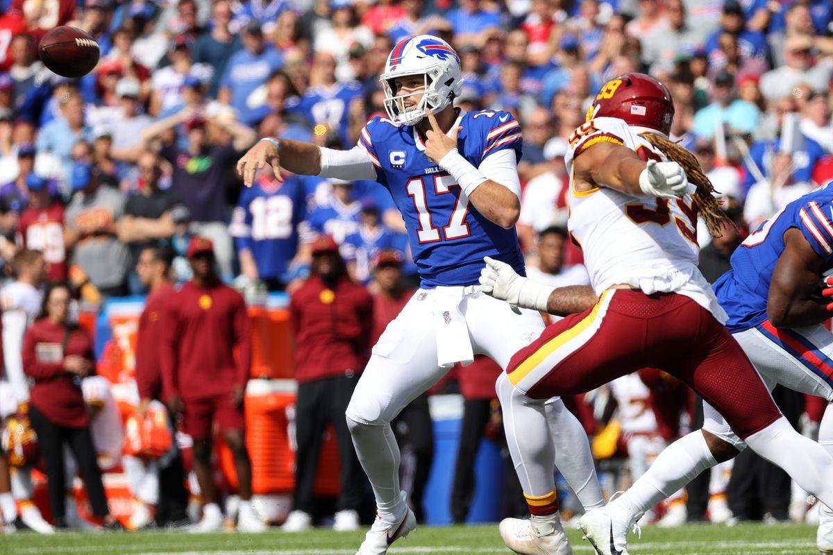 Bills quarterback Josh Allen dumps off a pass under pressure