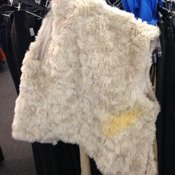 Furry vest with major stain, $99