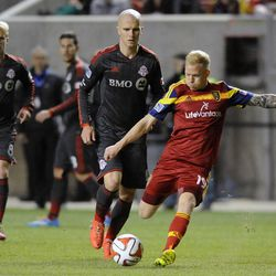 Real Salt Lake midfielder Luke Mulholland (19) boots the ball downfield during a game at Rio Tinto Stadium in Sandy on Saturday, March 29, 2014.