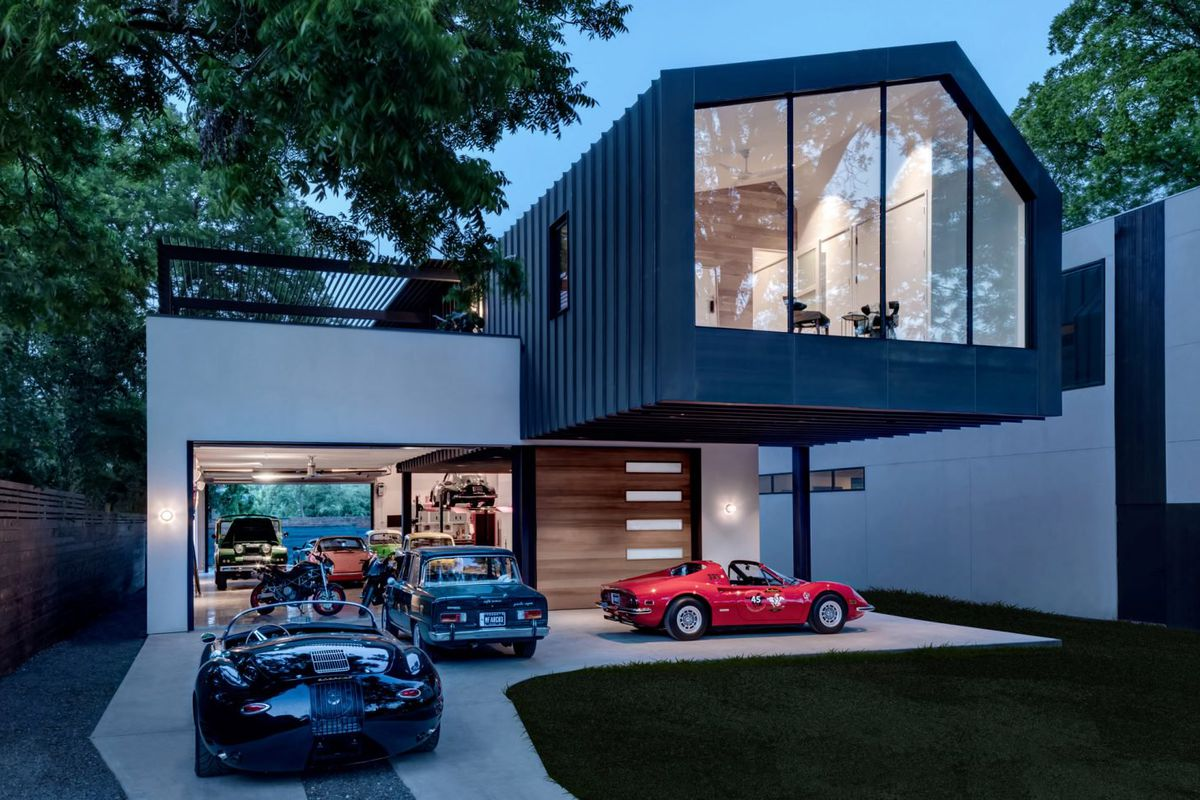 Modern home was designed for the car lover curbed for Garage orleans auto