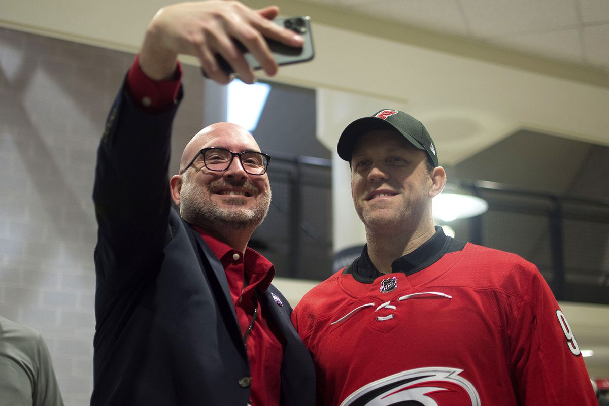 Wade Minter, in-arena announcer for the Hurricanes, takes a selfie with the Carolina Hurricanes legend David Ayres, Tuesday, Feb. 25, 2020 in PNC Arena prior to a game against the Dallas Stars. After goalies James Reimer and Petr Mrazek were injured in the game against Toronto, the Canes were forced to activate Ayres as the emergency back-up goalie. Ayres led the Canes to a comfortable 6-3 win over the Maple Leafs, instantly becoming a fan-favorite.