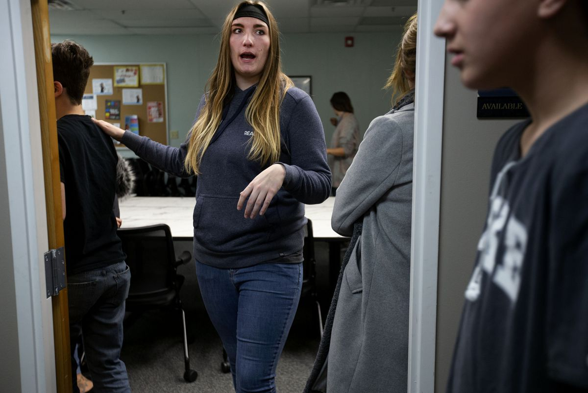 Natalie Clark directs teenagers in the Transition to Adult Living program before heading downtown to feed homeless people sandwiches and hot chocolate in Salt Lake City on Tuesday, Nov. 12, 2019. Transition to Adult Living provides youths assistance in transitioning from foster care to adult living.