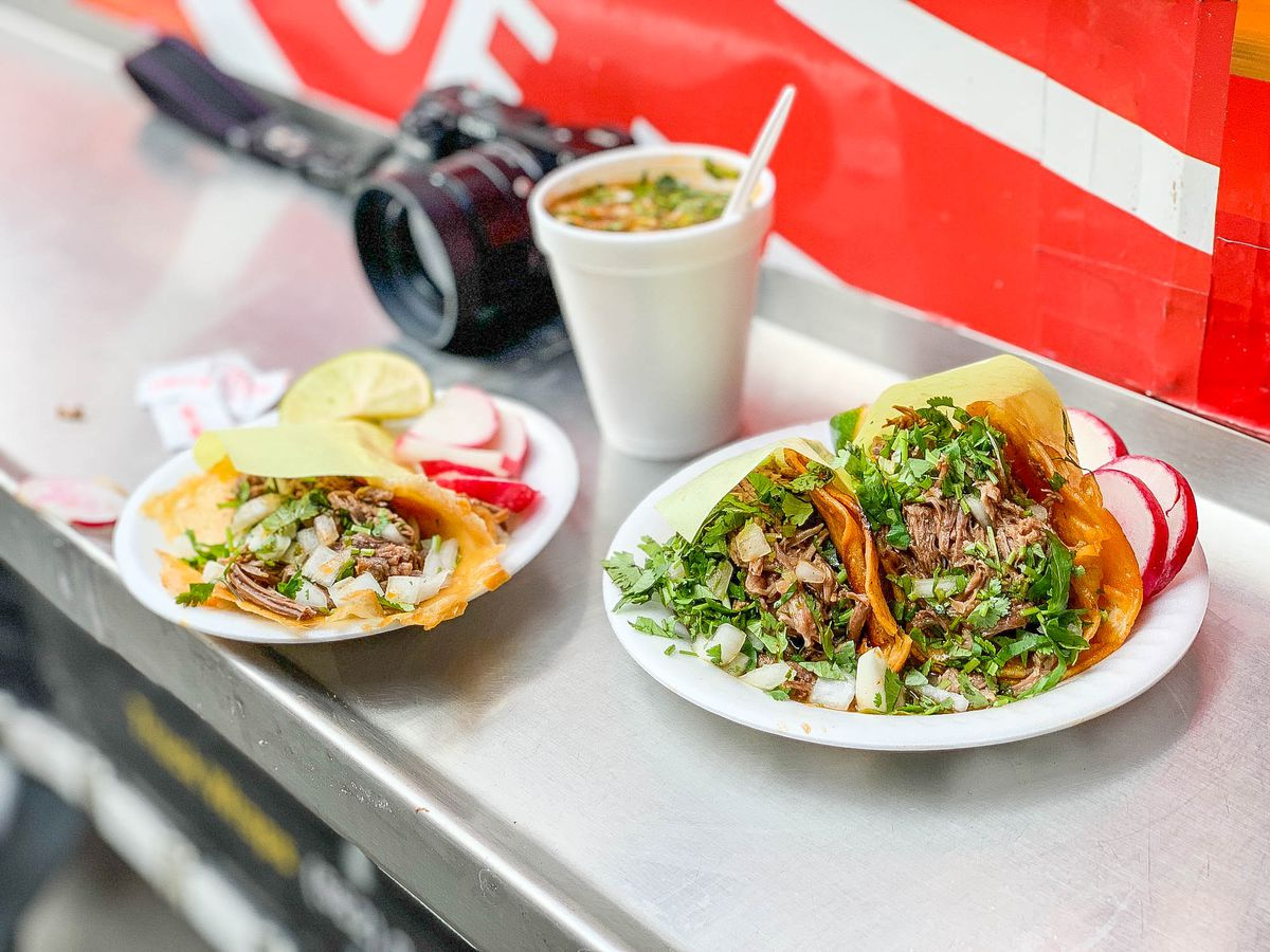 birria tacos truck on plates with camera
