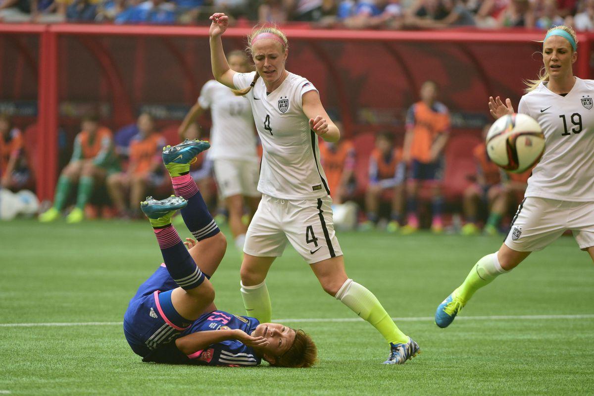 Japan forward Yuika Sugasawa (15) falls after battling US defender Becky Sauerbrunn in the final of the 2015 Women's World