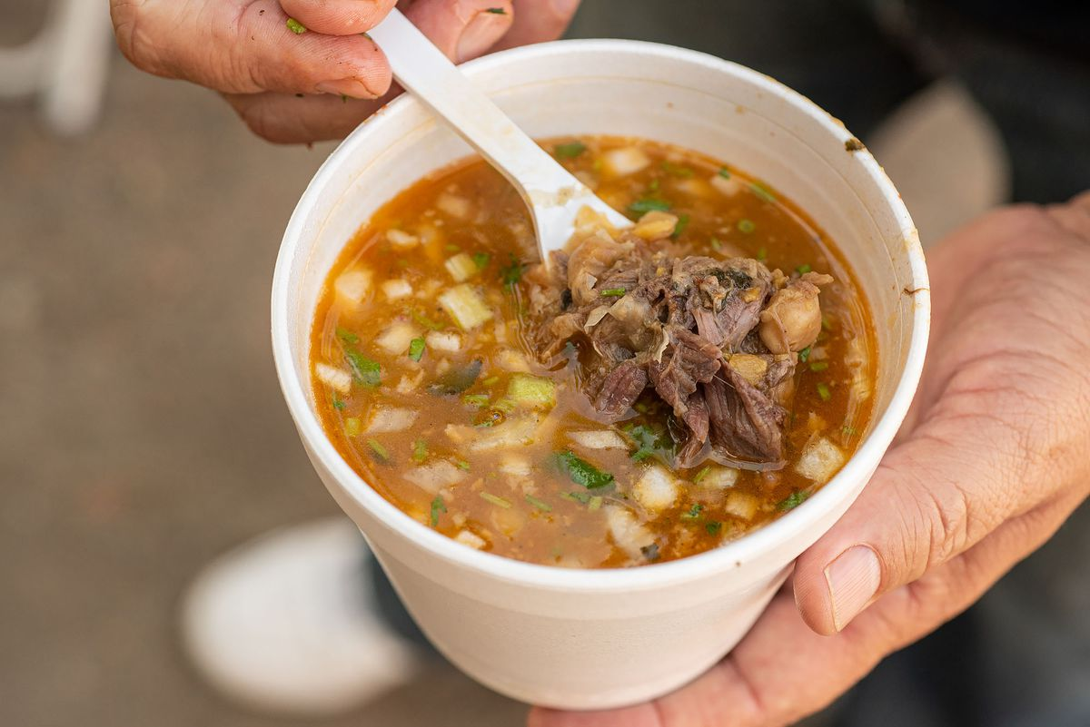 Consomé with garbanzo beans and chunks of barbacoa.