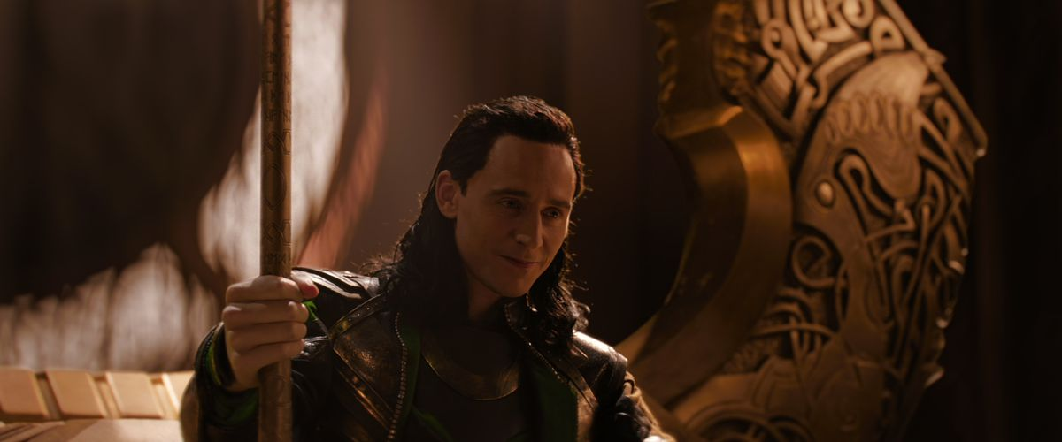 Loki sits on Odin's throne in a credits scene from Thor: The Dark World.