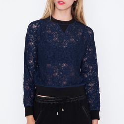 """<strong>Priory of Ten</strong> Rina Lace Sweatshirt, <a href=""""https://www.shopacrimony.com/products/priory-of-ten-rina-lace-sweatshirt"""">$298</a> at Acrimony"""