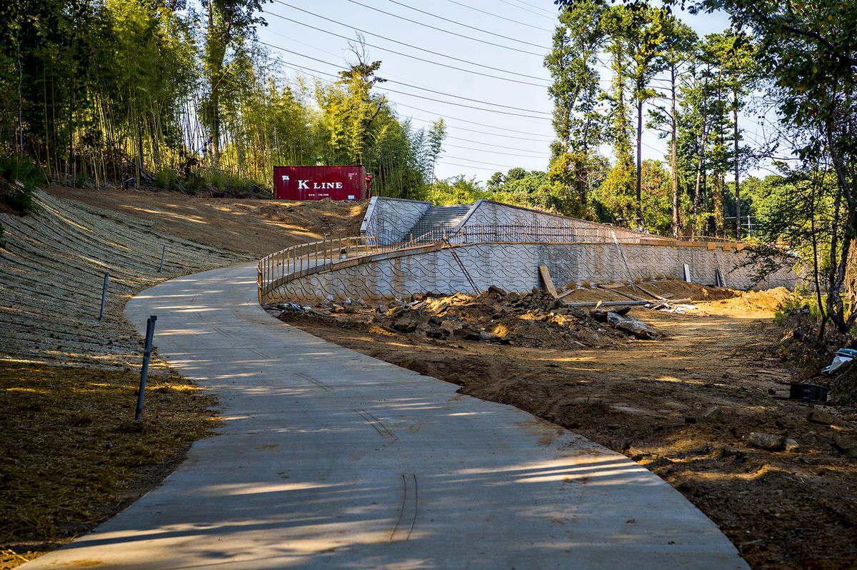 A swooping trail bends to the right, still under construction.