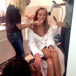 Model Sarah Dumont getting prepped by makeup artist Fara Homidi and hair stylist Tuan Anh Tran.