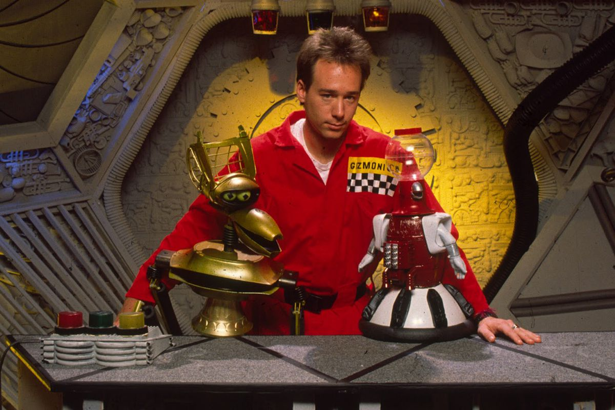 Joel (Joel Hodgson) hangs out with robots Crow (left) and Tom Servo on board the Satellite of Love.