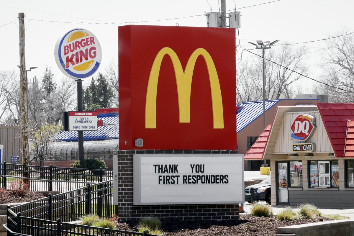 Burger King, Dairy Queen and McDonalds fast food restaurants on the same block in Omaha, Neb., Wednesday, April 15, 2020. (AP Photo/Nati Harnik)