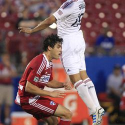 Real Salt Lake Alvaro Saborio (15) jumps for a header against FC Dallas Yordany Alvarez  (14) during the first half of an MLS soccer game on Wednesday, April 25, 2012, in Frisco, Texas.