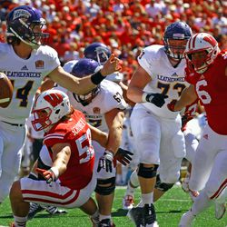 Western Illinois Quarterback Trenton Norvell is chased down by Wisconsin Defensive End Alec James
