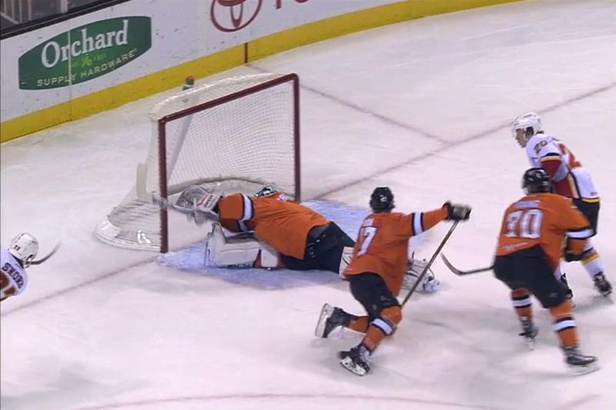 San Jose Barracuda goaltender Troy Grosenick fully extends to rob Stockton Heat forward Drew Shore of a goal in the first period Sunday afternoon at SAP Center. (AHL Live)