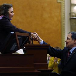 Gov. Gary Herbert shakes hands with House Speaker Becky Lockhart, R-Provo after speaking in the House of Representatives at the Capitol in Salt Lake City on Friday, March 14, 2014. Lockhart, the first woman to serve as Utah House speaker, died at her home Saturday, Jan. 17, 2015, from an unrecoverable and extremely rare neurodegenerative brain disease. She was 46.